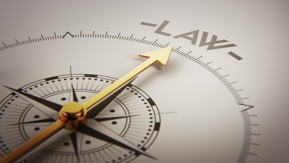 A shutterstock image of a compass pointing to the word law.